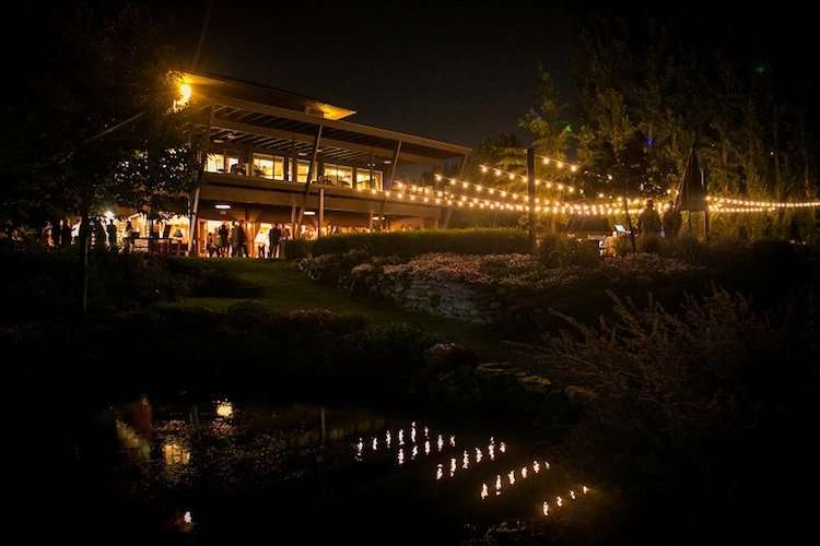 Beacon Hill Clubhouse and Gardens at night with bistro lights